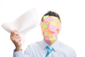 Businessman covered in stickers on white background
