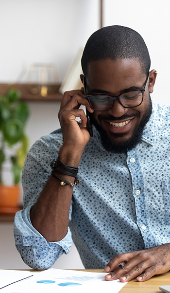 10 Reasons Why You Should Use Voice Broadcasting | Everlytic | Digital Communication Software | Email Marketing | Man on phone | African man on phone | African man smiling on phone