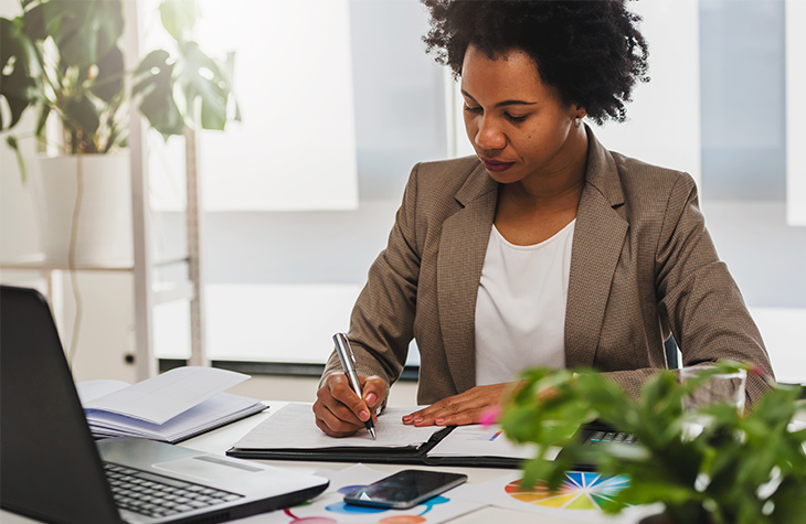 How & Why to Communicate During COVID-19   Marketing   Blog   Everlytic   Woman working from home   Blog feature image