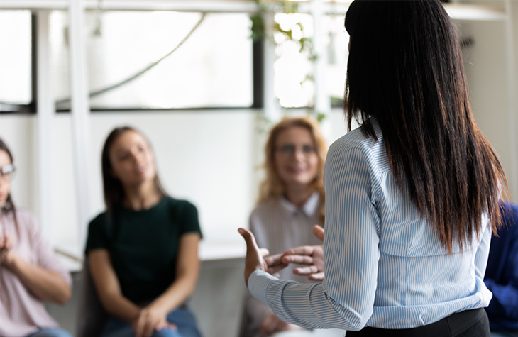 How to Compile a Crisis Communication Team | Everlytic | Email automation software | Blog image | Woman presenting to team
