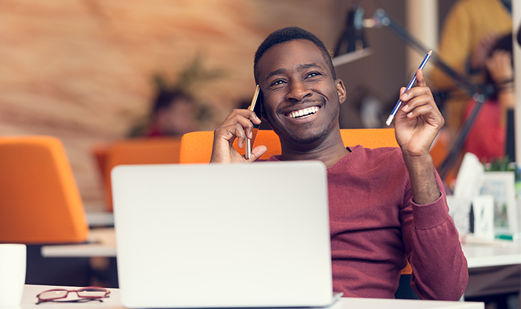 Improve Customer Retention by Marketing Beyond the Sale | Everlytic | Happy working man on phone