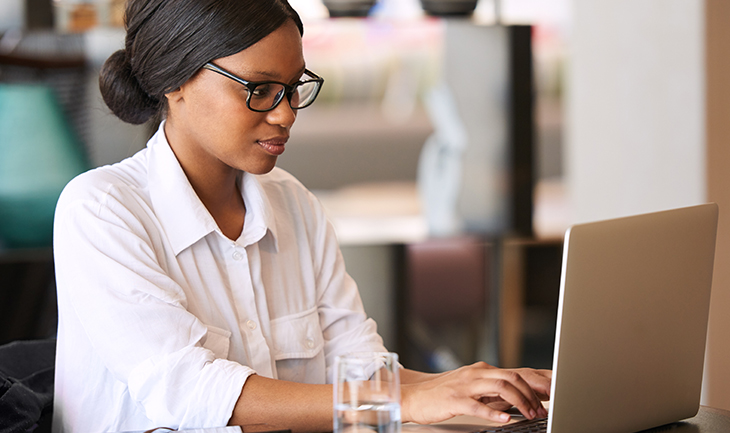 Improve Customer Retention by Marketing Beyond the Sale | Everlytic | Woman on Laptop