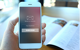 POPIA Q&A: Getting Consent for Direct Marketing | Hand with cell phone | Feature image